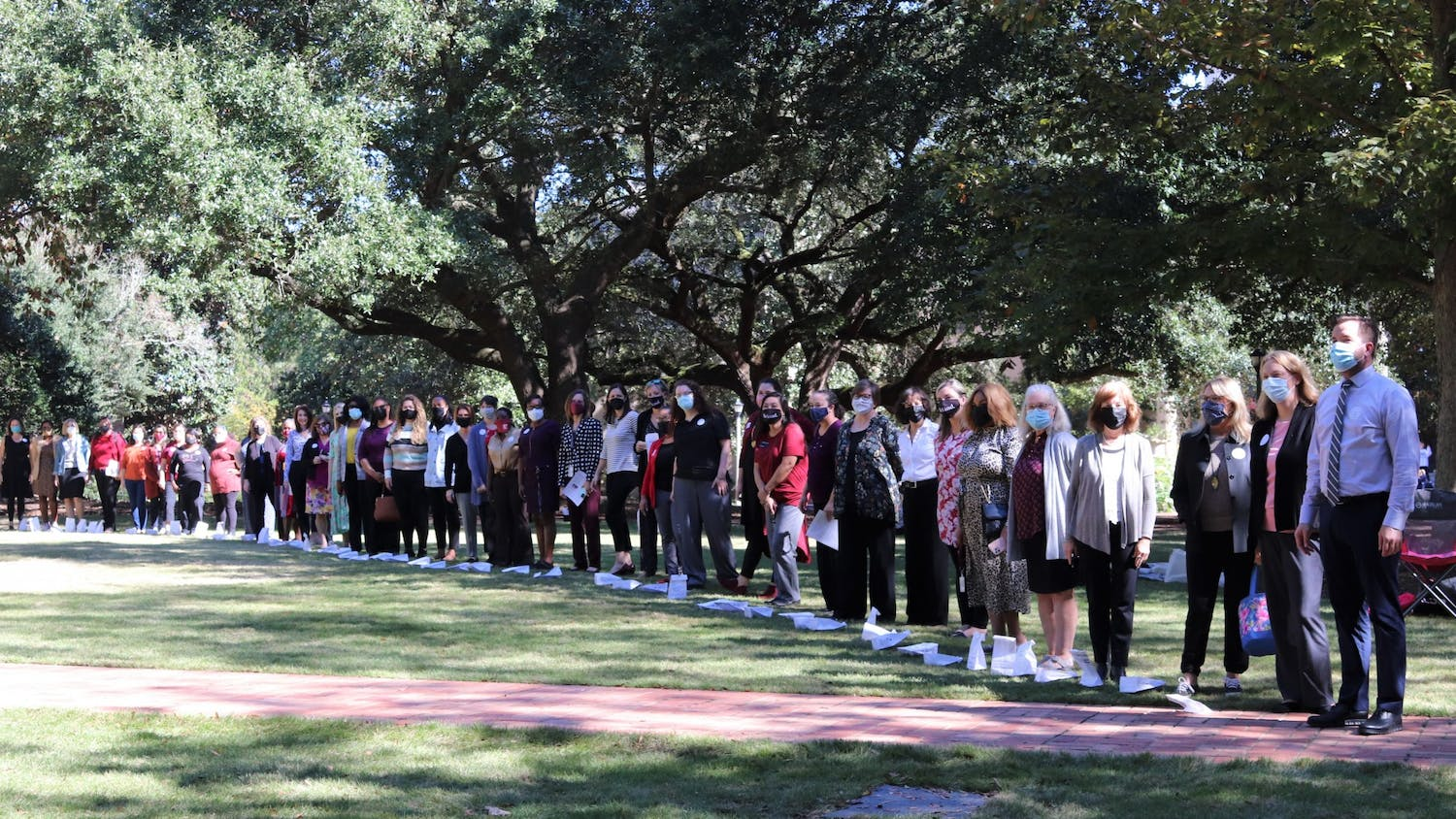 Attendees of the Lighting the Way for Women Leaders event gathers together on the Horseshoe on Oct. 26, 2021.