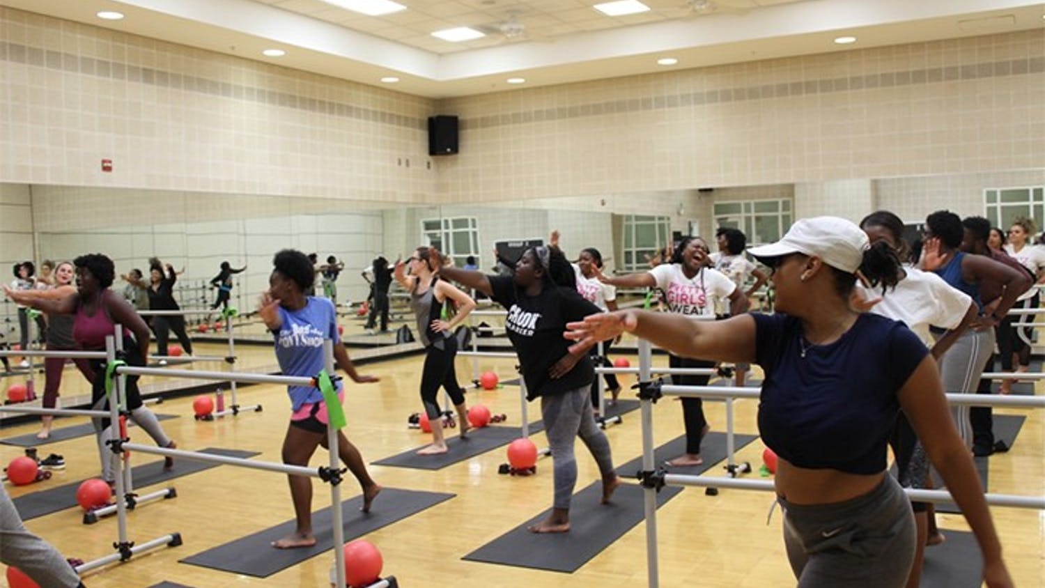 Members of USC's PRETTY GIRLS SWEAT chapter exercise in Strom Thurmond Wellness and Fitness Center. The members use a variety of equipment during their sessions.