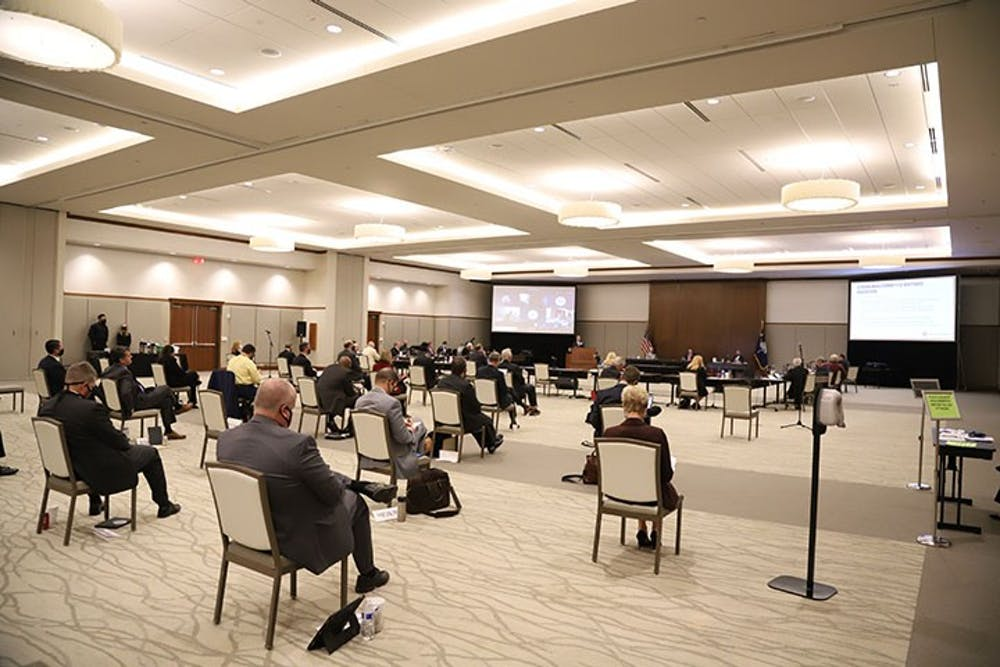 <p>The board of trustees meeting in the Alumni Center ballroom on Friday, Oct. 9. The room had chairs spread out due to COVID-19 requirements, and the attendees wore masks.</p>
