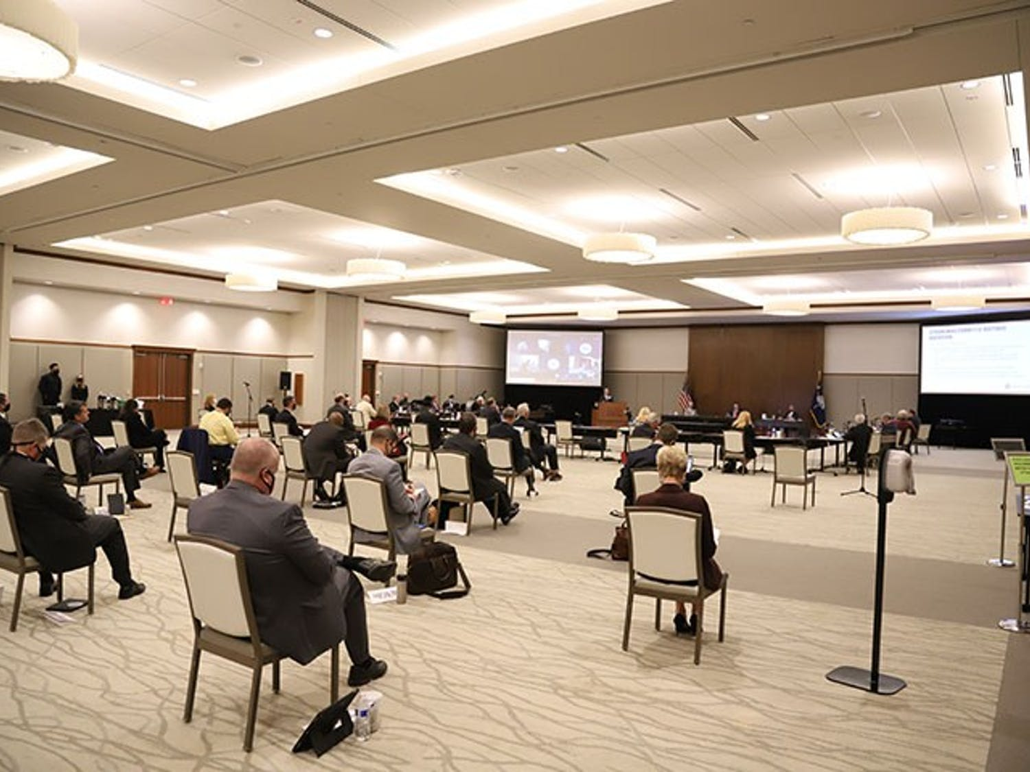The board of trustees meeting in the Alumni Center ballroom on Friday, Oct. 9. The room had chairs spread out due to COVID-19 requirements, and the attendees wore masks.