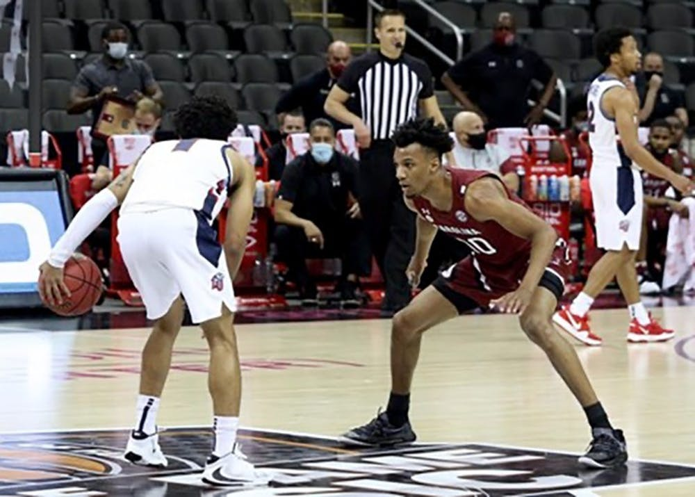 Junior guard AJ Lawson faces a Liberty player during the game. The Liberty Flames defeated the Gamecocks 78-62.