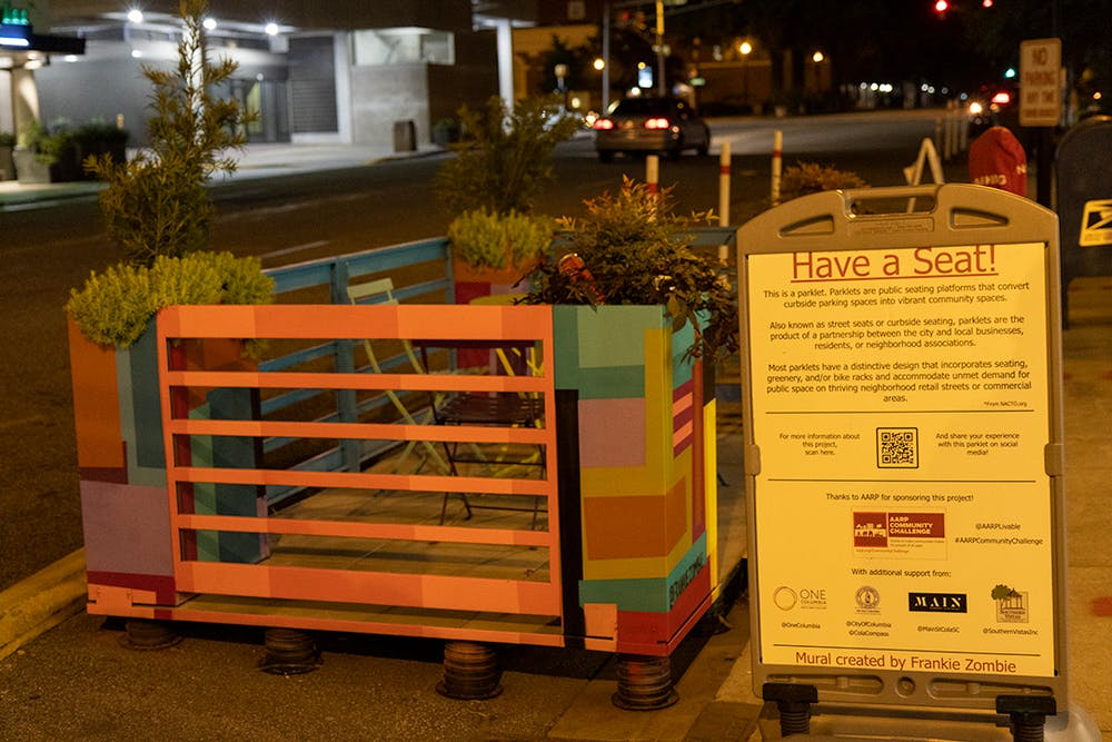 <p>An art installation by Frankie Zombie resides in a parking spot on Washington St. outside of Stoners Pizza Joint. While most are temporary, this installation was the first permanent one to hit the streets of downtown Columbia.</p>