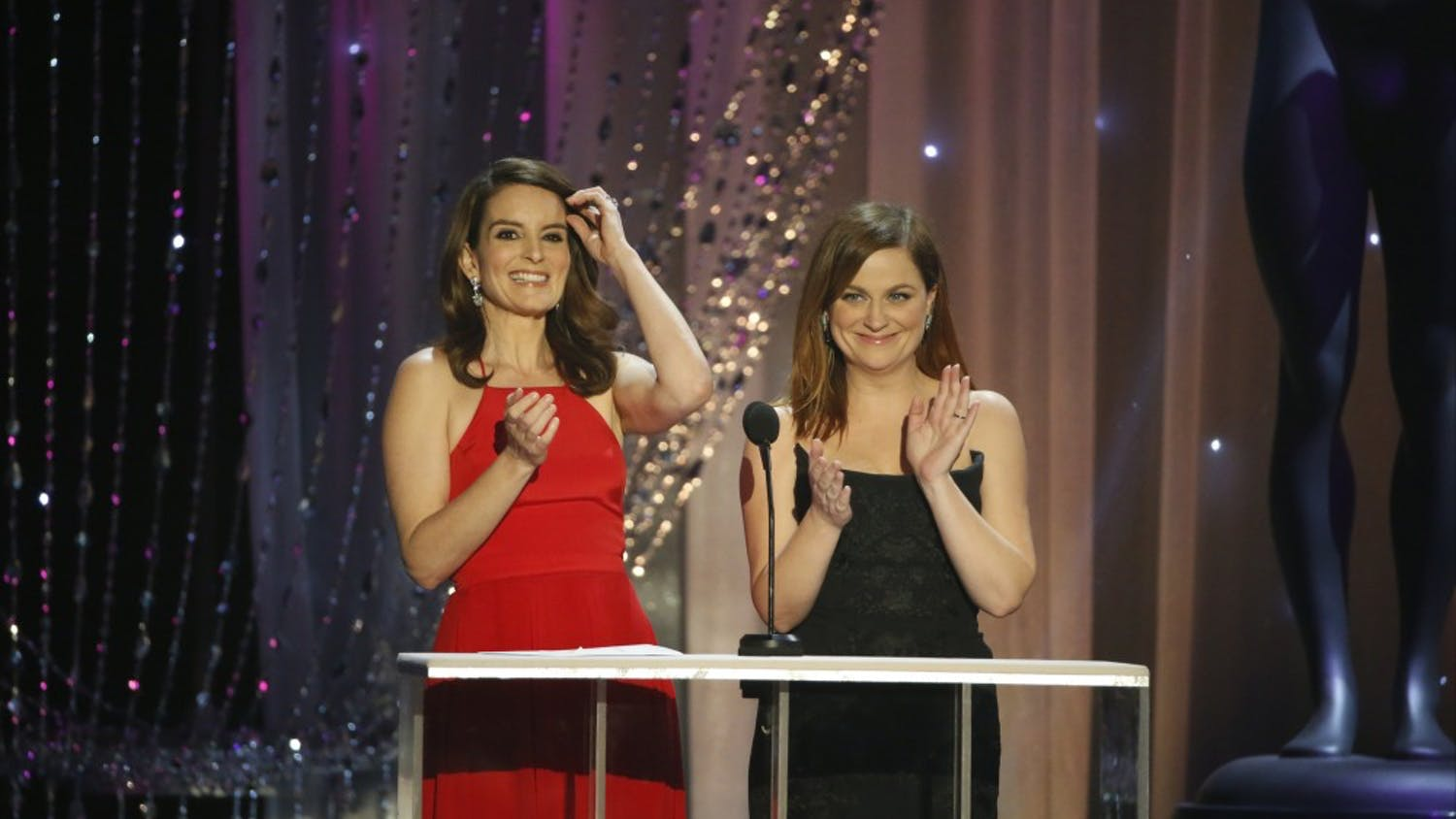 Tina Fey, left, and Amy Poehler on stage at the 22nd Annual Screen Actors Guild Awards at the Shrine Auditorium in Los Angeles on Saturday, Jan. 30, 2016. (Robert Gauthier/Los Angeles Times/TNS)