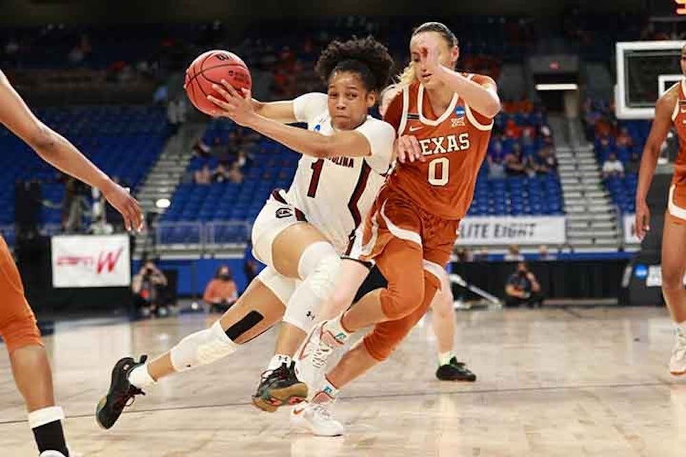 Sophomore guard Zia Cooke runs and dribbles between two Longhorn players. The Gamecocks beat the Longhorns 62-34, letting them advance to the Final Four.