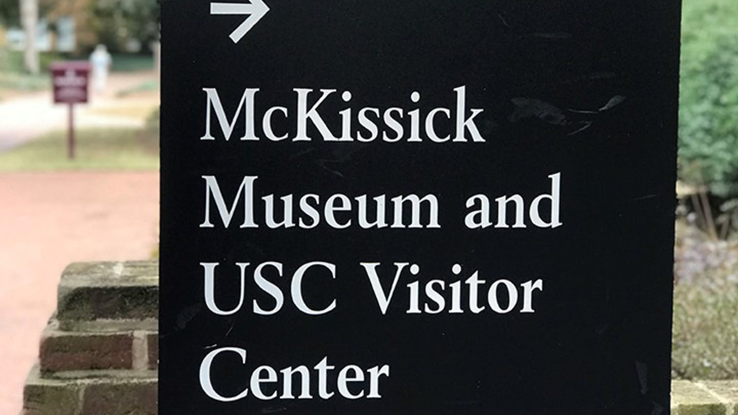 """A university sign points toward the direction of the McKissick Museum, which is located just off the Horseshoe. The museum has been home to multiple exhibits in the past but is currently home to """"Child's Play,"""" which was created by Leslie Yarborough."""