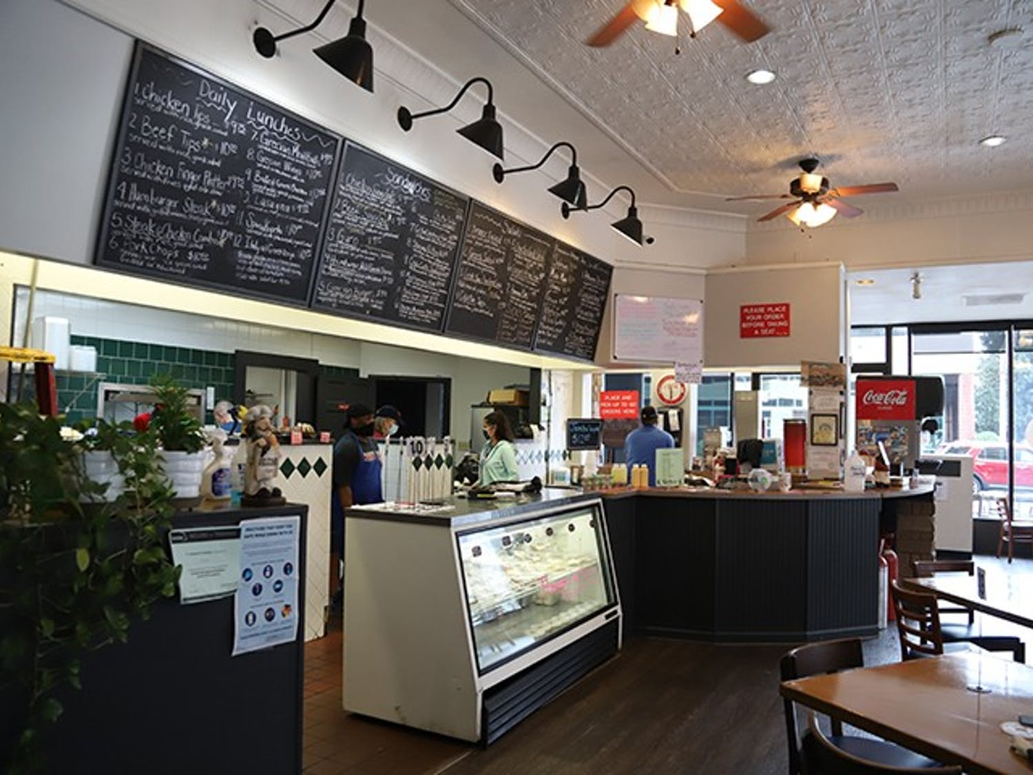 The inside counter, right below a row of menus where customers will place their orders. The restaurant provides both indoor and outdoor seating.