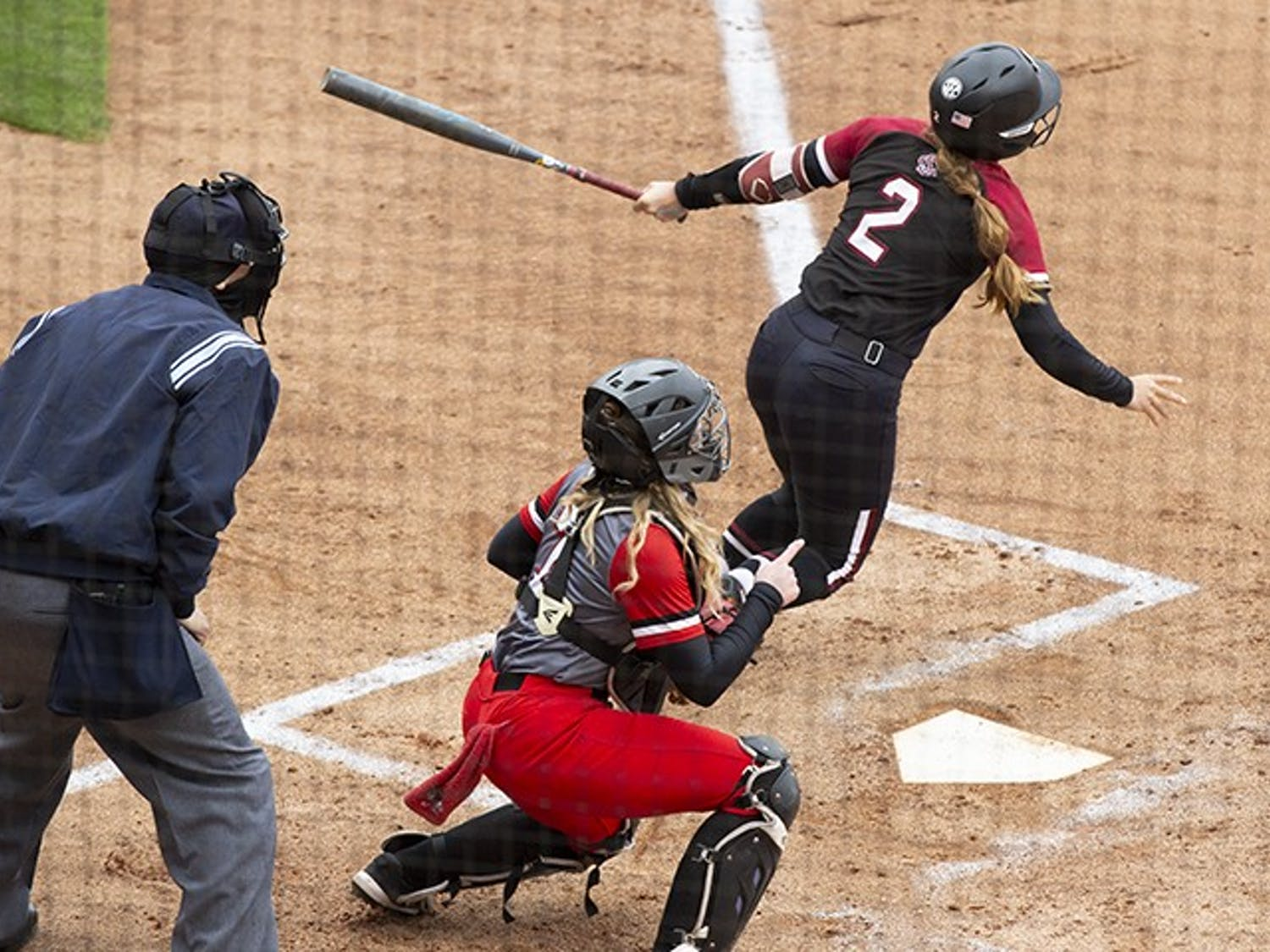 Graduate infielder Kenzi Maguire prepares to run after swinging at a ball from the opposing pitcher. South Carolina won 8-0 against Gardner-Webb University.