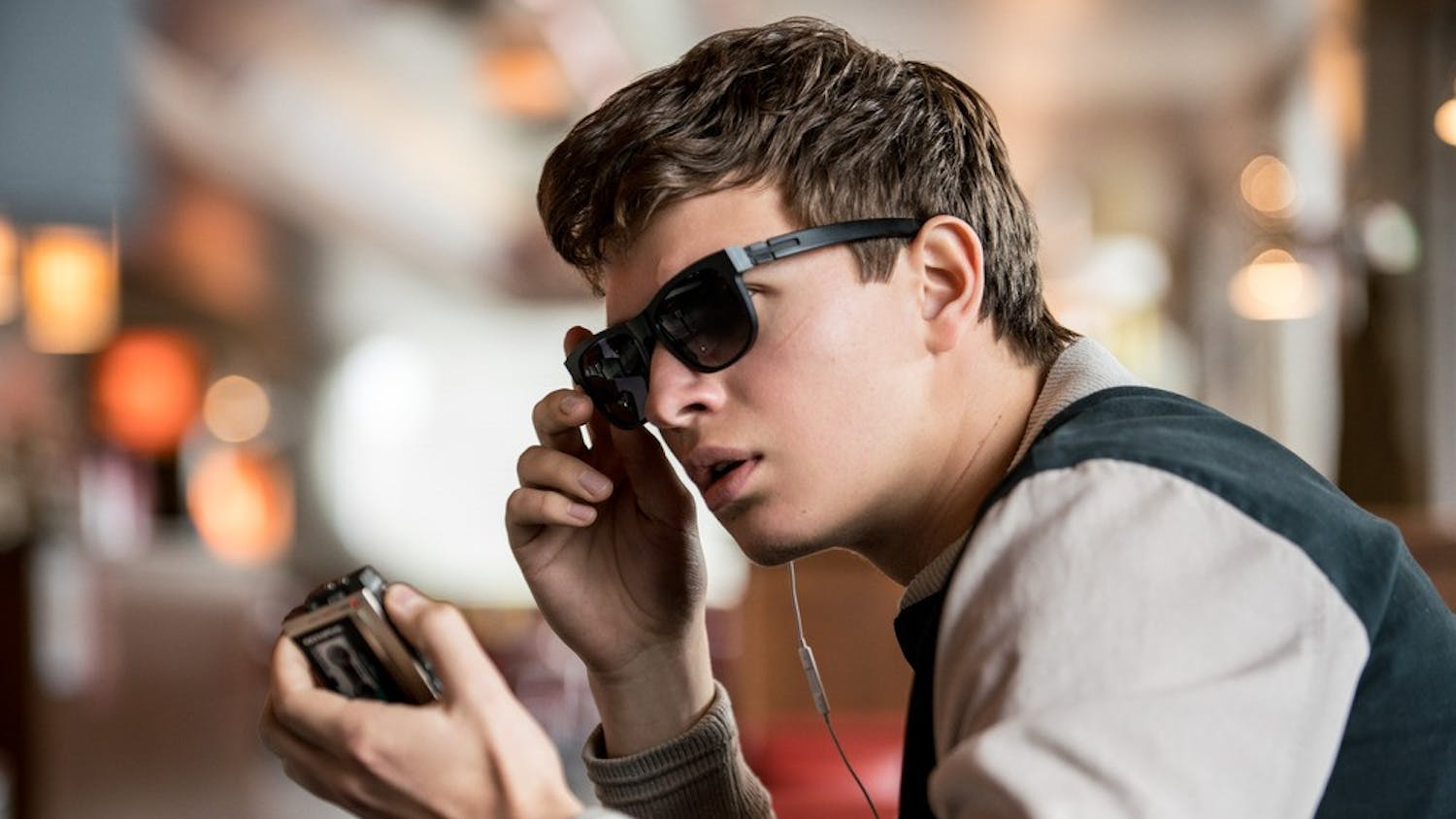 Baby (ANSEL ELGORT) charms Debora as she works in TriStar Pictures' BABY DRIVER.