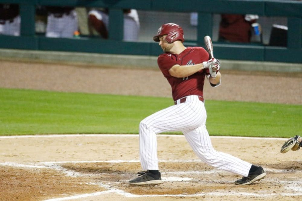 <p>Senior right fielder Andrew Eyster swings at a pitch during Tuesday's game against UNC. The Gamecocks fell to the Tar Heels 3-2 in 10 innings.</p>