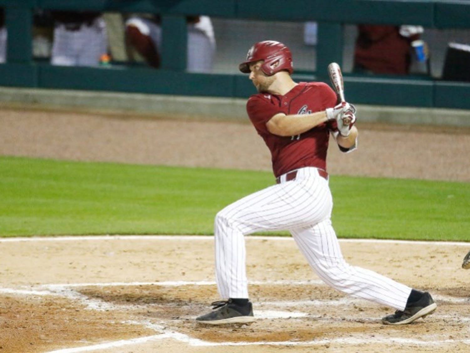 Senior right fielder Andrew Eyster swings at a pitch during Tuesday's game against UNC. The Gamecocks fell to the Tar Heels 3-2 in 10 innings.