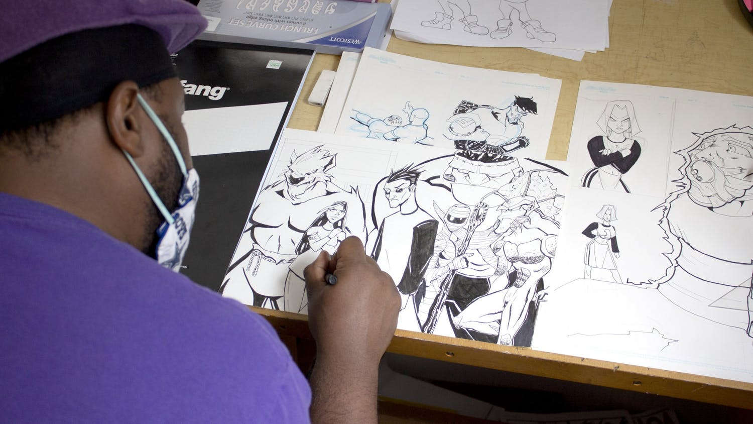"""Corey """"Roc Bottom"""" Davis works on several unfinished pieces in his home studio in Columbia, South Carolina. In the future, Davis said, he hopes to open a gallery to promote artists in the Columbia community."""