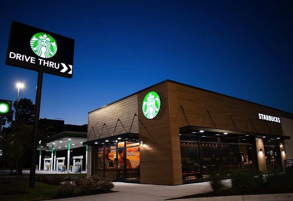 """<p>The new community-oriented Starbucks, with Lauren Andreu and Jared Owens's mural, """"A Great Cloud of Witness"""" visible from inside. This location near campus is more centered around local outreach and creating opportunities than generating profits.&nbsp;</p>"""
