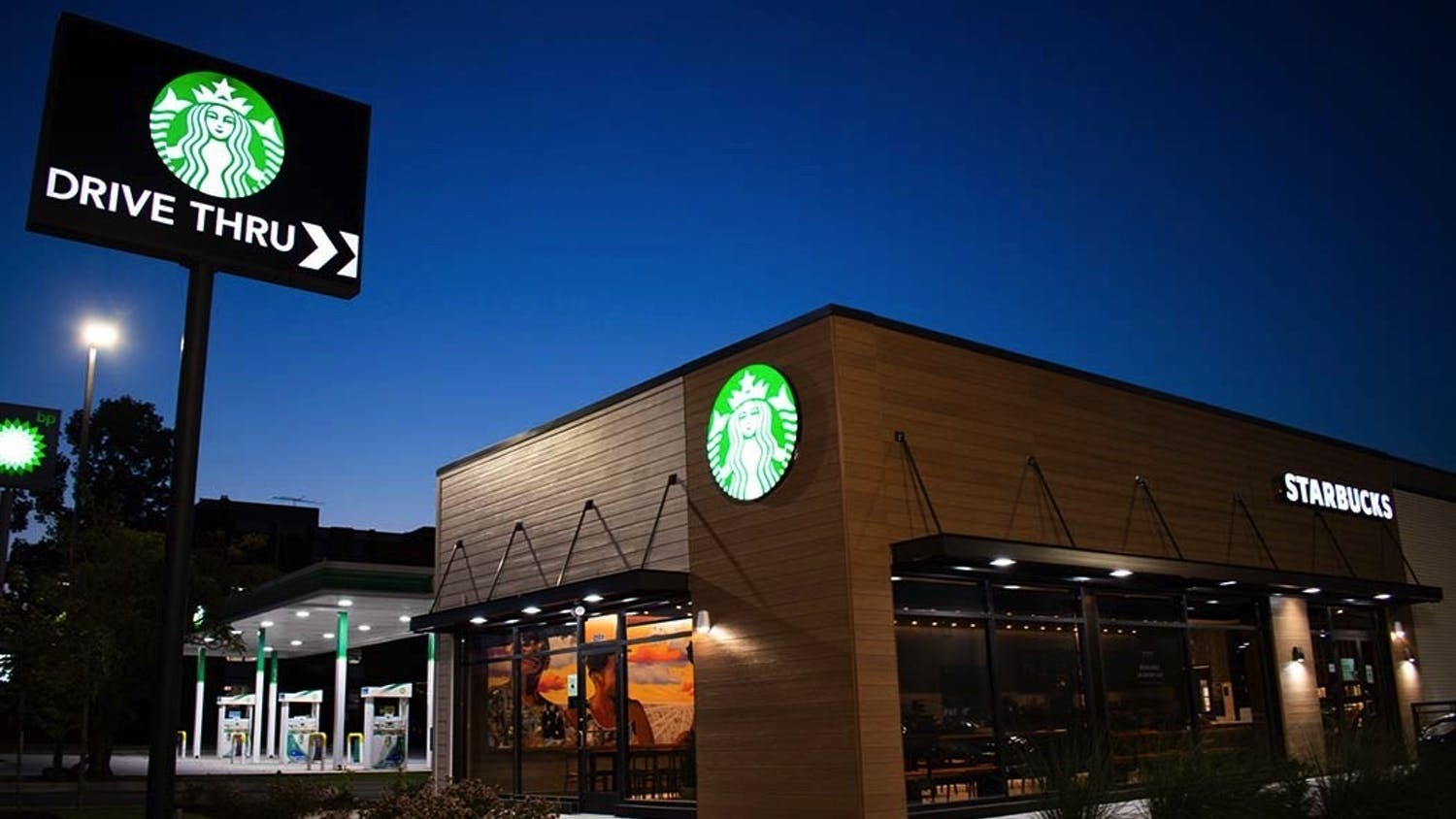 """The new community-oriented Starbucks, with Lauren Andreu and Jared Owens's mural, """"A Great Cloud of Witness"""" visible from inside. This location near campus is more centered around local outreach and creating opportunities than generating profits."""