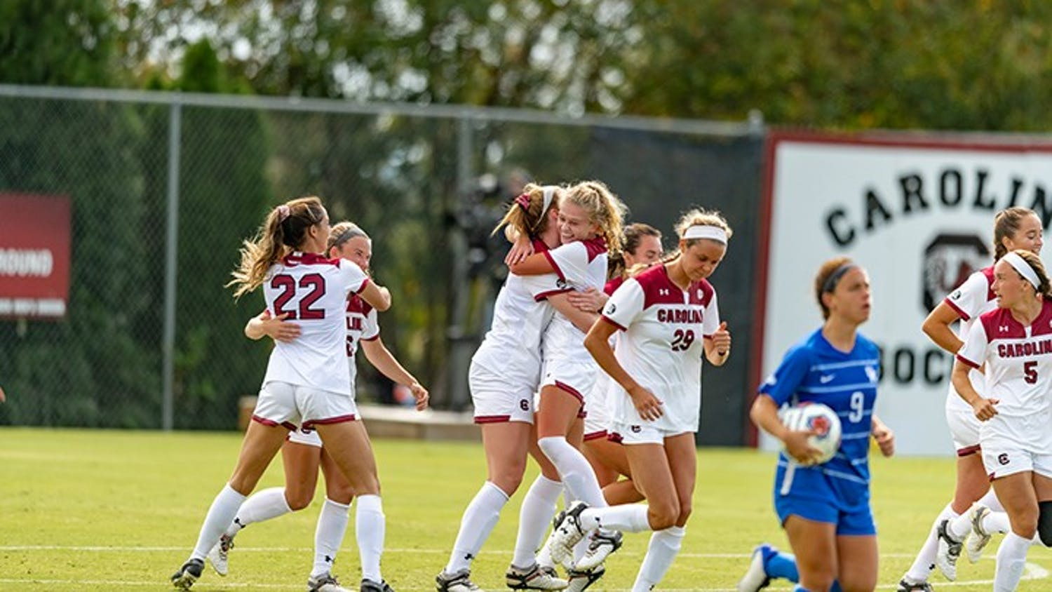 Members of the woman's soccer team celebrate after a goal against Kentucky. The Gamecocks beat the Wildcats 1-0.