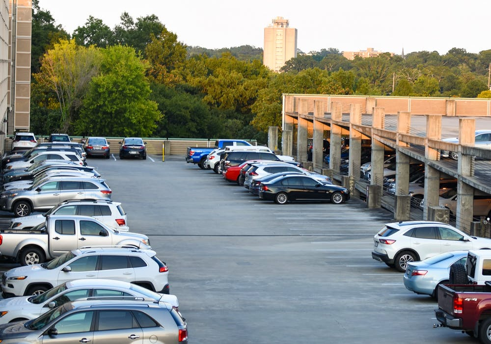 <p>Cars parked on the top levels of the Bull Street Parking Garage. The university is expanding parking options toward the borders of campus to encourage walking and biking, which some students say further limits parking.&nbsp;</p>