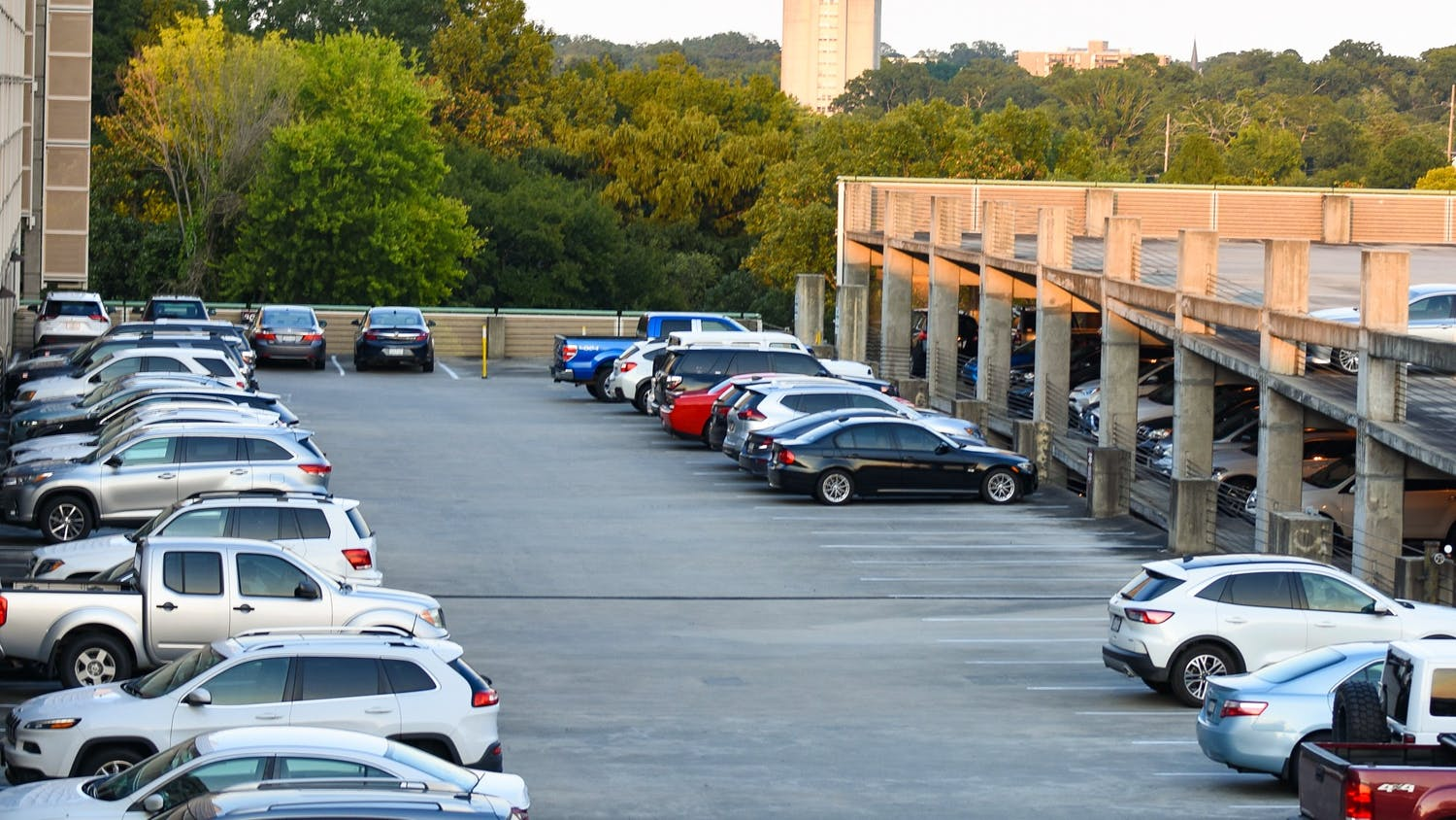 Cars parked on the top levels of the Bull Street Parking Garage. The university is expanding parking options toward the borders of campus to encourage walking and biking, which some students say further limits parking.
