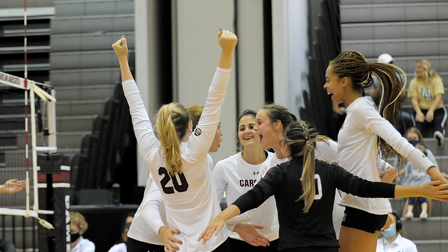 The Women's Volleyball team is greeted by teammates after their 3-0 victory against Alabama. This win follows the loss against Alabama on the previous day.