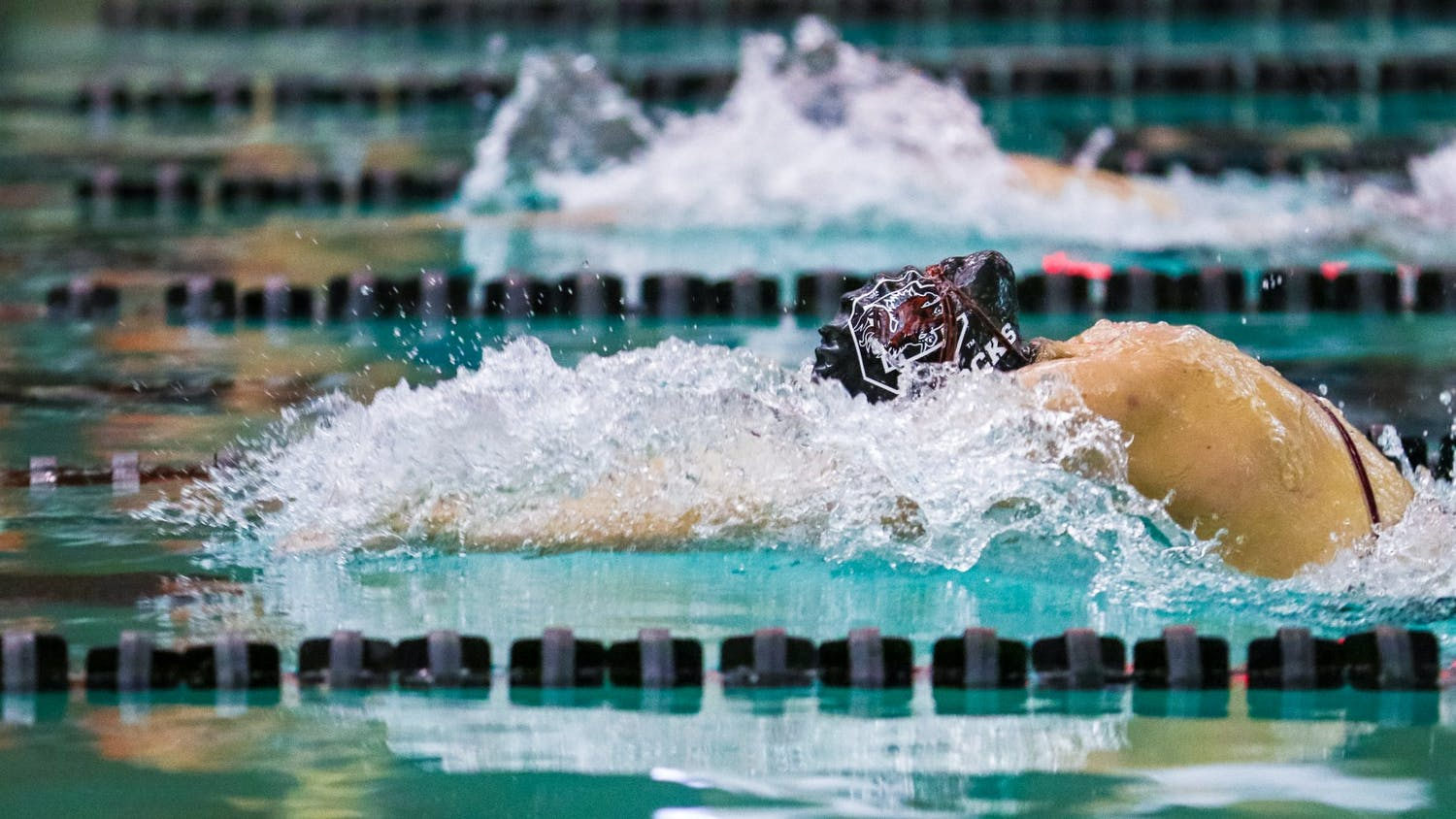 Freshman Maddy Norford swims the 100-meter breaststroke during the Gamecocks' meet against Georgia Tech on Jan. 18, 2020. The team earned a win at home, 197-103.
