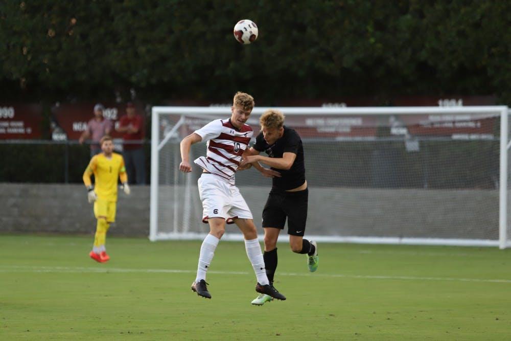 <p>Gamecock senior forward Tucker Monheimer goes up for a header in the Sept. 18 match against Furman at Stone Stadium. South Carolina beat Furman 3-0.</p>