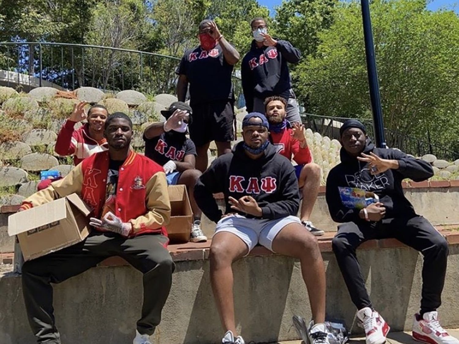 Brothers of the Zeta Epsilon chapter of Kappa Alpha Psi help feed the homeless at Finley Park.