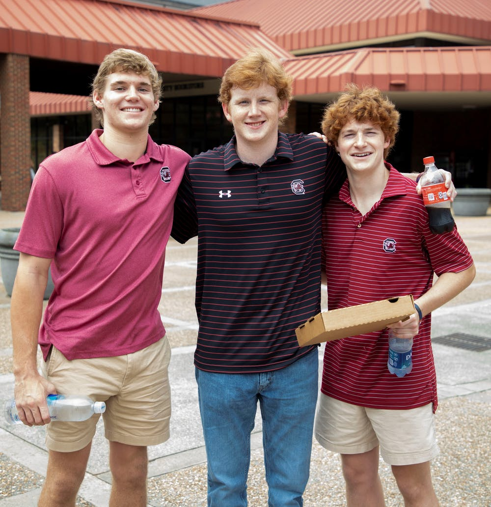<p>Carson Shay and Jason and Ryan Hill, Gamecock fans, at the Sanford Stadium before the Georgia vs. South Carolina game Saturday, Sept. 18, 2021.</p>