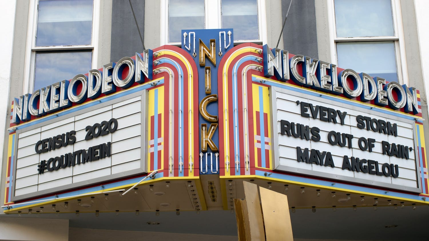 The marquee on the exterior of The Nickelodeon displays a hashtag referring to the census and a Maya Angelou quote. While the theater has canceled all in-person screenings due to COVID-19, it continues to offer virtual screening rooms.