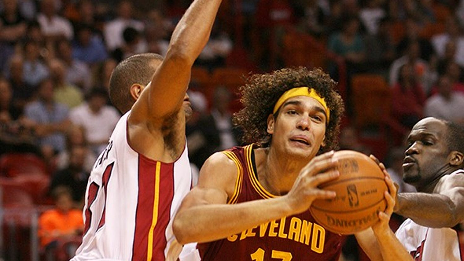 The Cleveland Cavaliers' Anderson Varejao (17) goes to the basket against Shane Battier, left, and Joel Anthony of the Miami Heat during the first quarter at the AmericanAirlines Arena in Miami, Florida, on Tuesday, January 24, 2012. Miami topped Cleveland, 92-85. (David Santiago/Miami Herald/MCT)