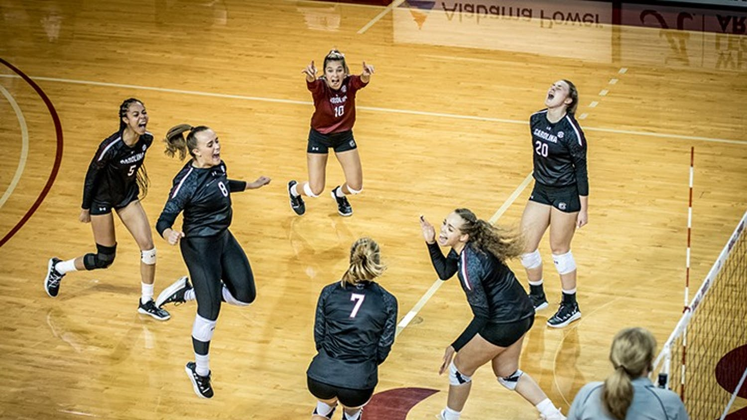 Members of the volleyball team celebrate a point. South Carolina came out with a 3-2 victory at Alabama Saturday afternoon.