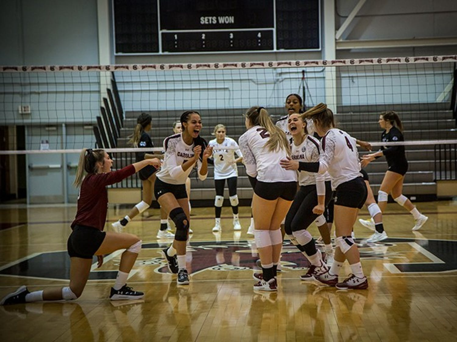 Members of the UofSC women's volleyball team celebrate after scoring a point against Mississippi State. The Gamecocks improved their record to 5-1 at home after the win.