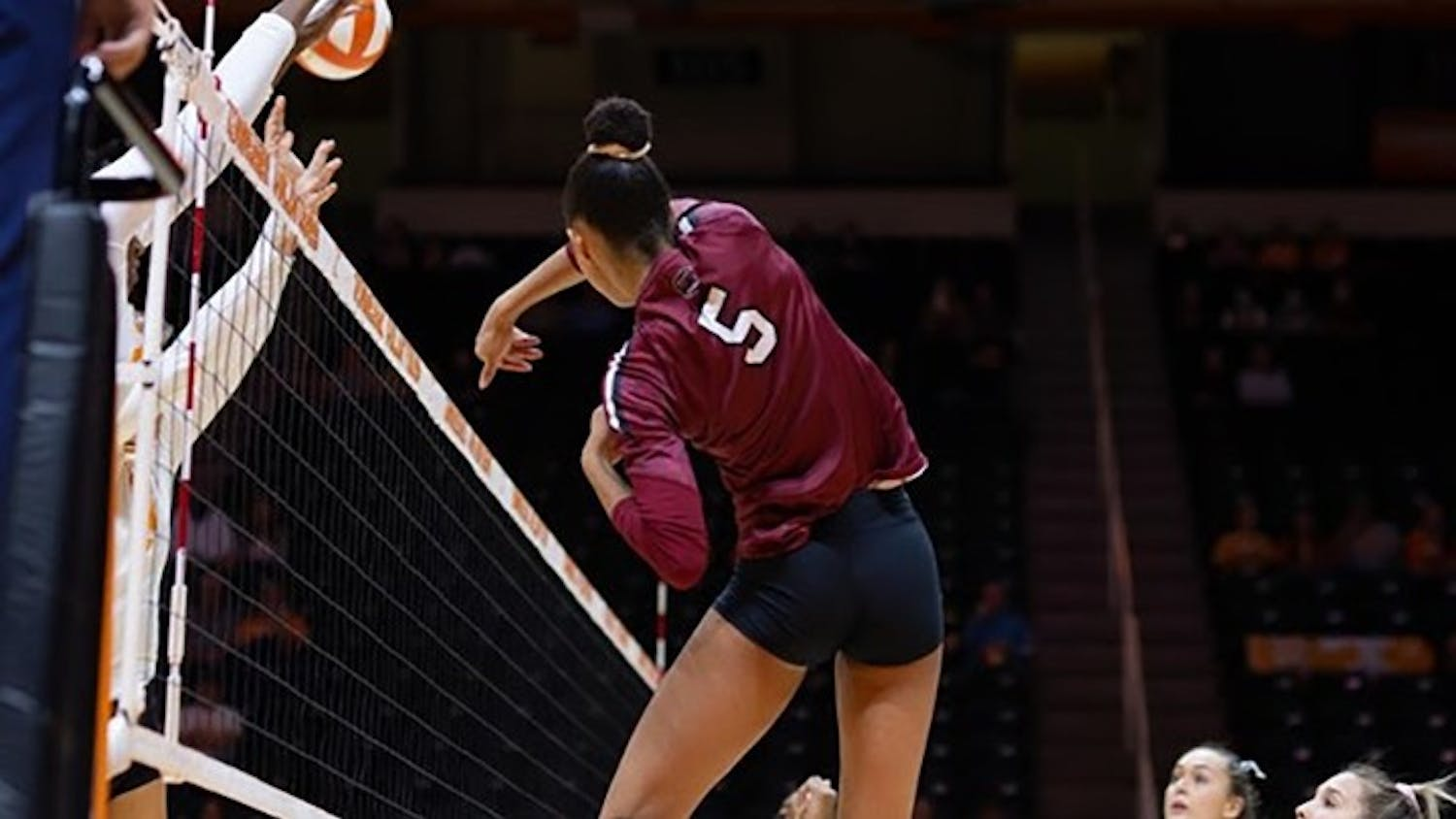 Graduate student outside hitter/left side Kyla Manning jumps from left side to swing at the ball. Within her one season at USC, Manning has 273 kills and six blocks.