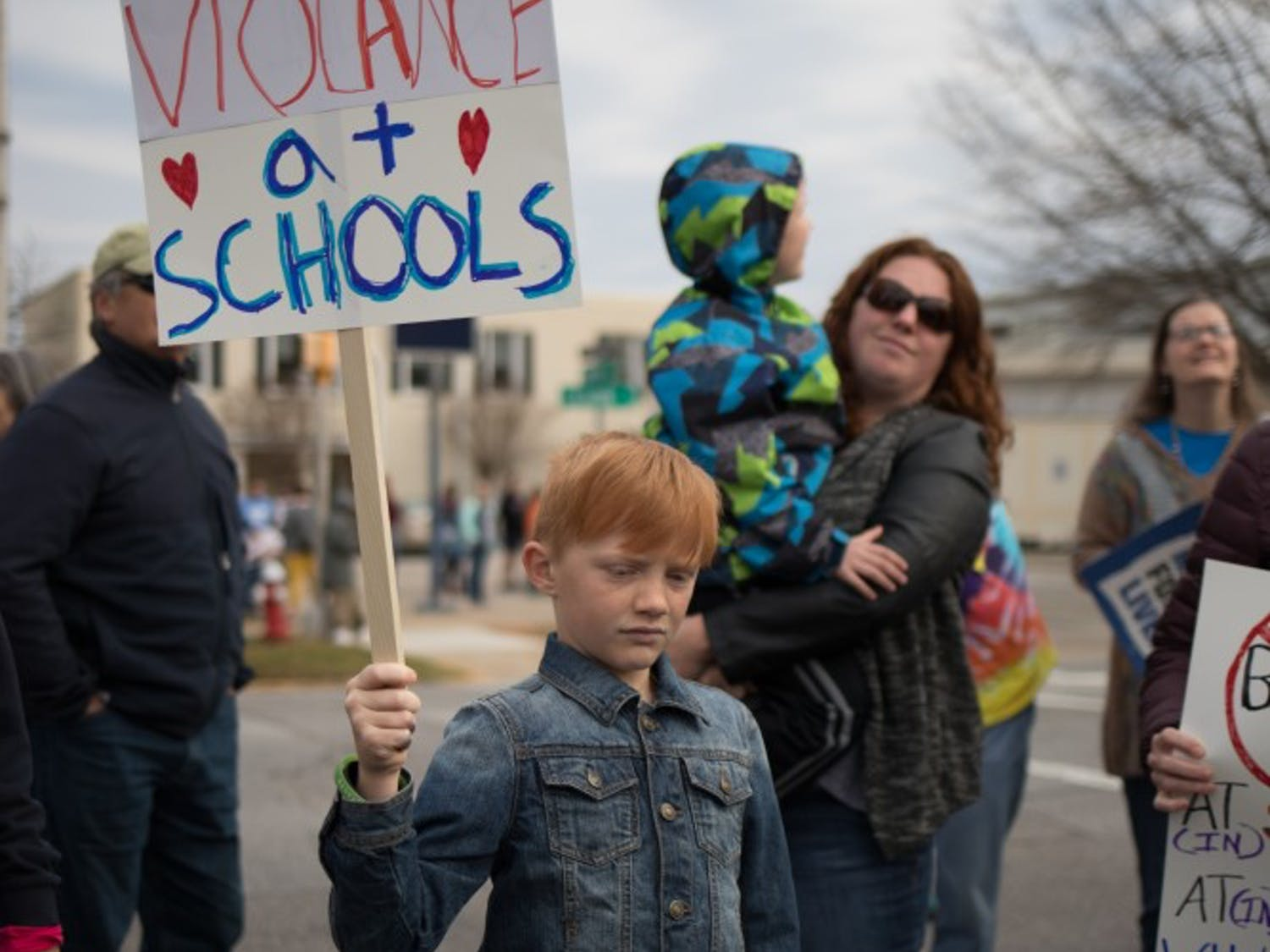 A child holds a sign about gun violence in schools at the March for Our Lives rally in Columbia Nov. 15, 2018.