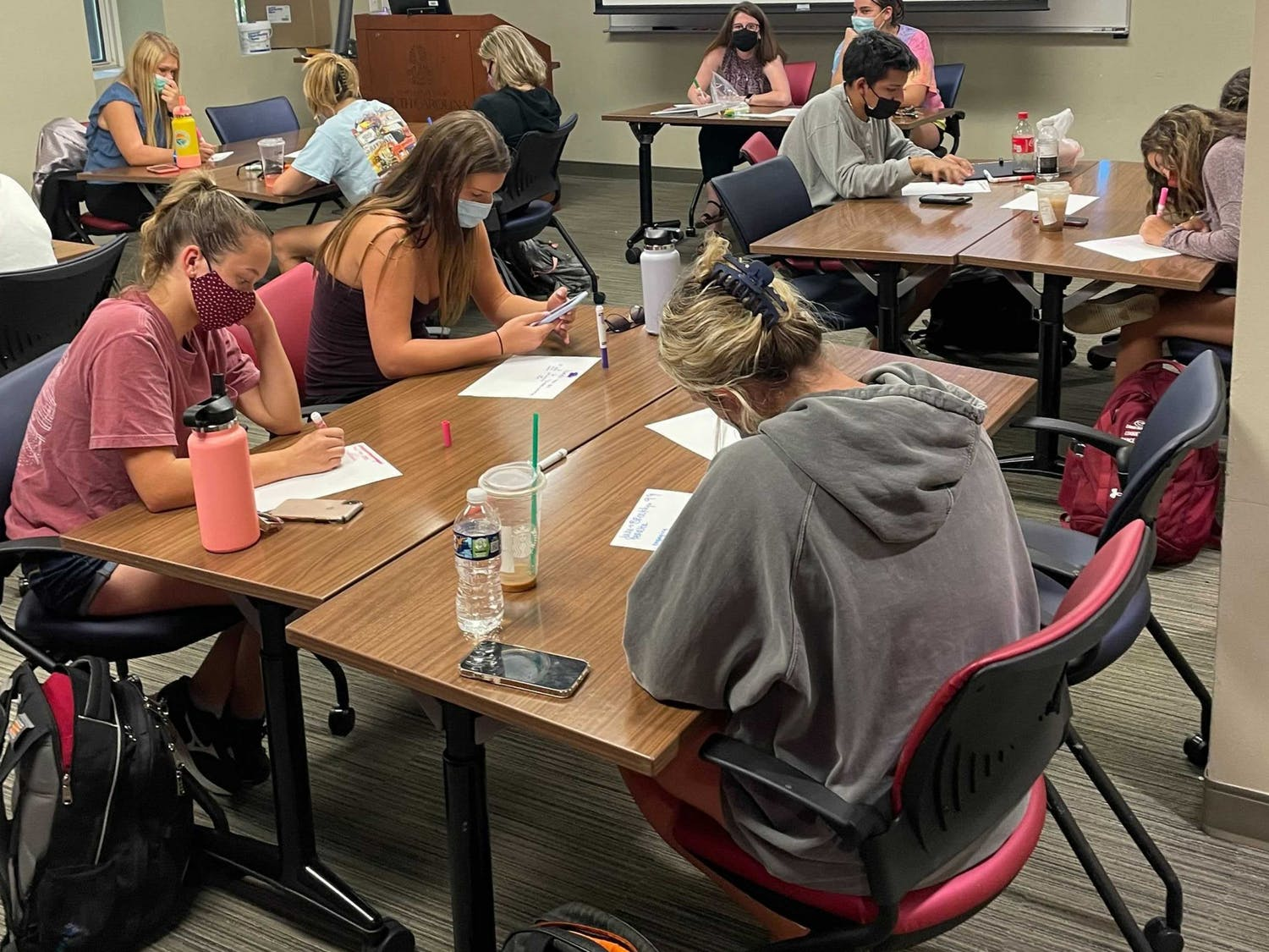Peer leaders are working on their lesson plans for the students in U101.