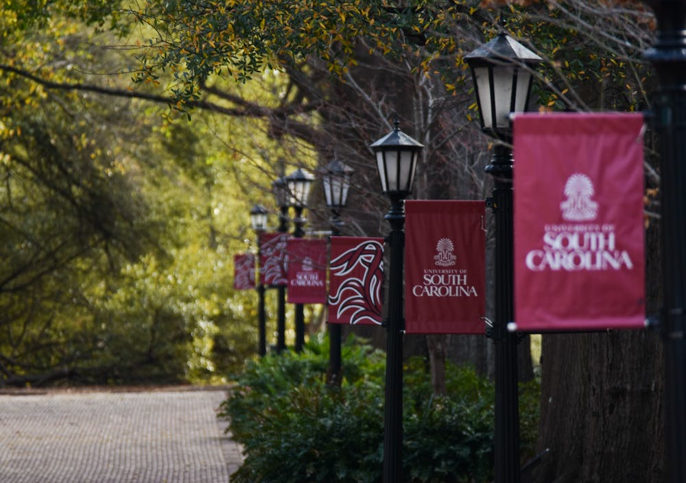 <p>USC banners on lamp posts lining the Horseshoe at sunrise.&nbsp;</p>