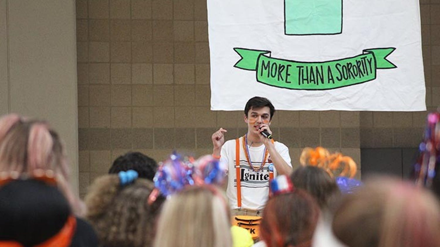 First-year economics student Seth Hajzus shares his experience with crowd at Dance Marathon and speaks about the families that he has met through working with the organization.