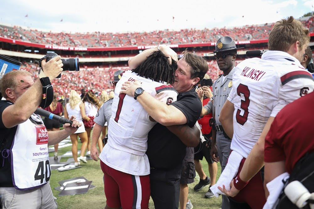 <p>Coach Will Muschamp celebrates the upset victory over No. 3 UGA with sophomore defensive back Jaycee Horn.</p>