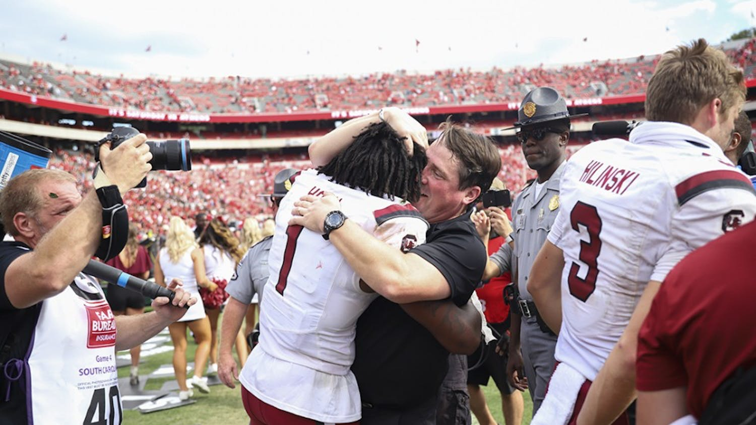 Coach Will Muschamp celebrates the upset victory over No. 3 UGA with sophomore defensive back Jaycee Horn.