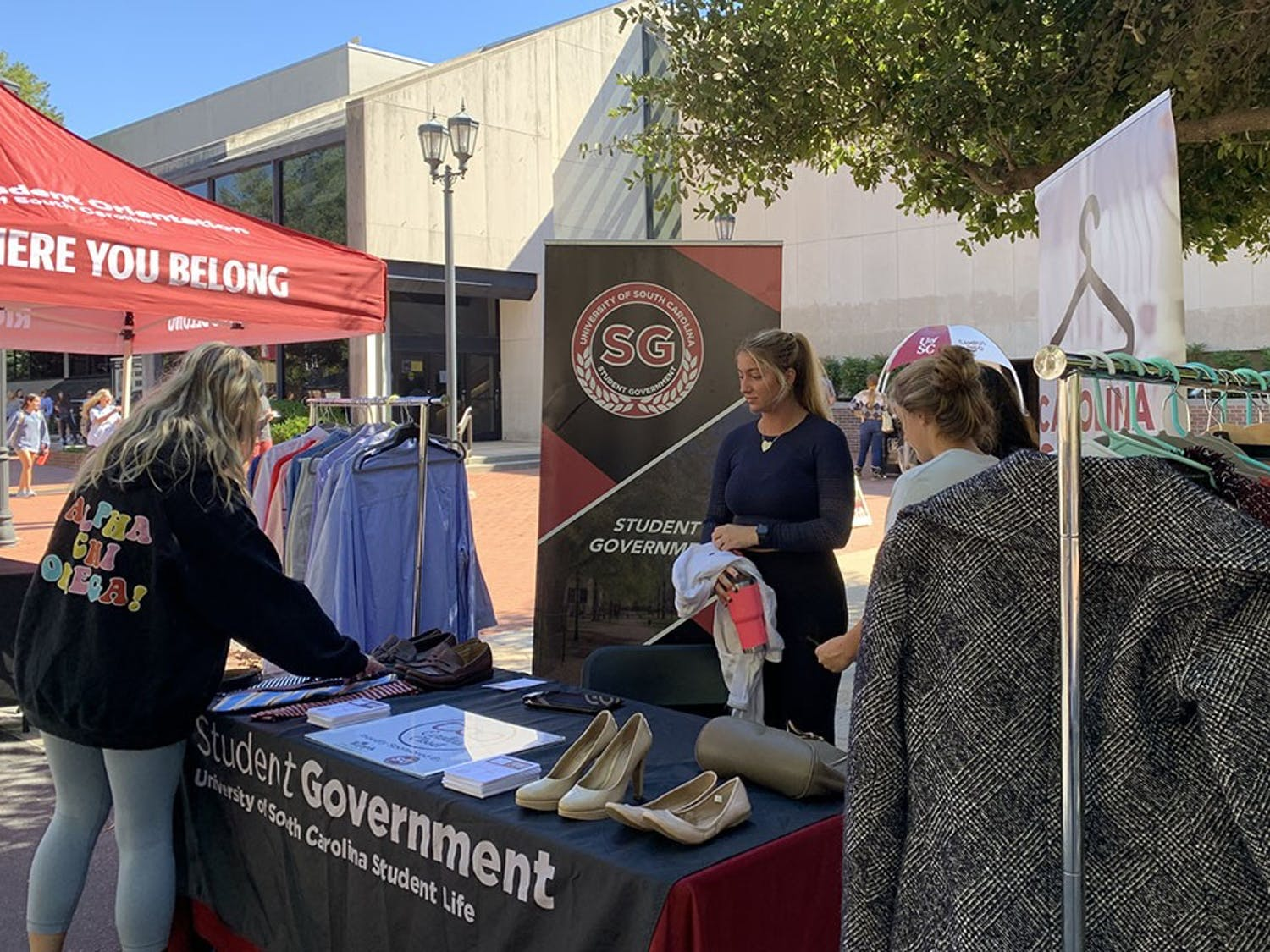 A student looks at ties at the pop-up Carolina Closet on Greene Street. The pop-up was a part of Student Government's Key Week.