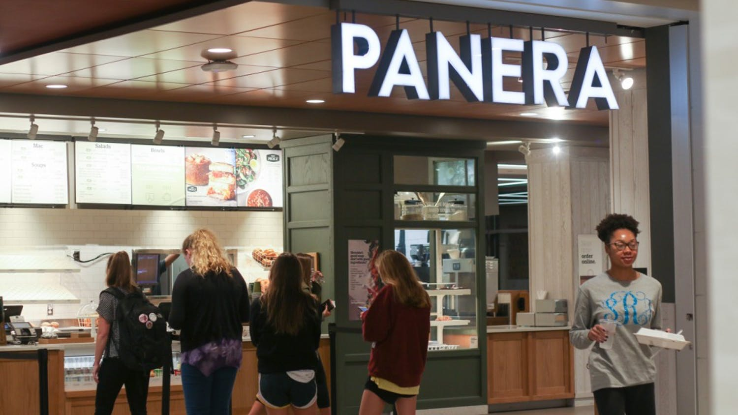 Students stand in line at Panera Bread.