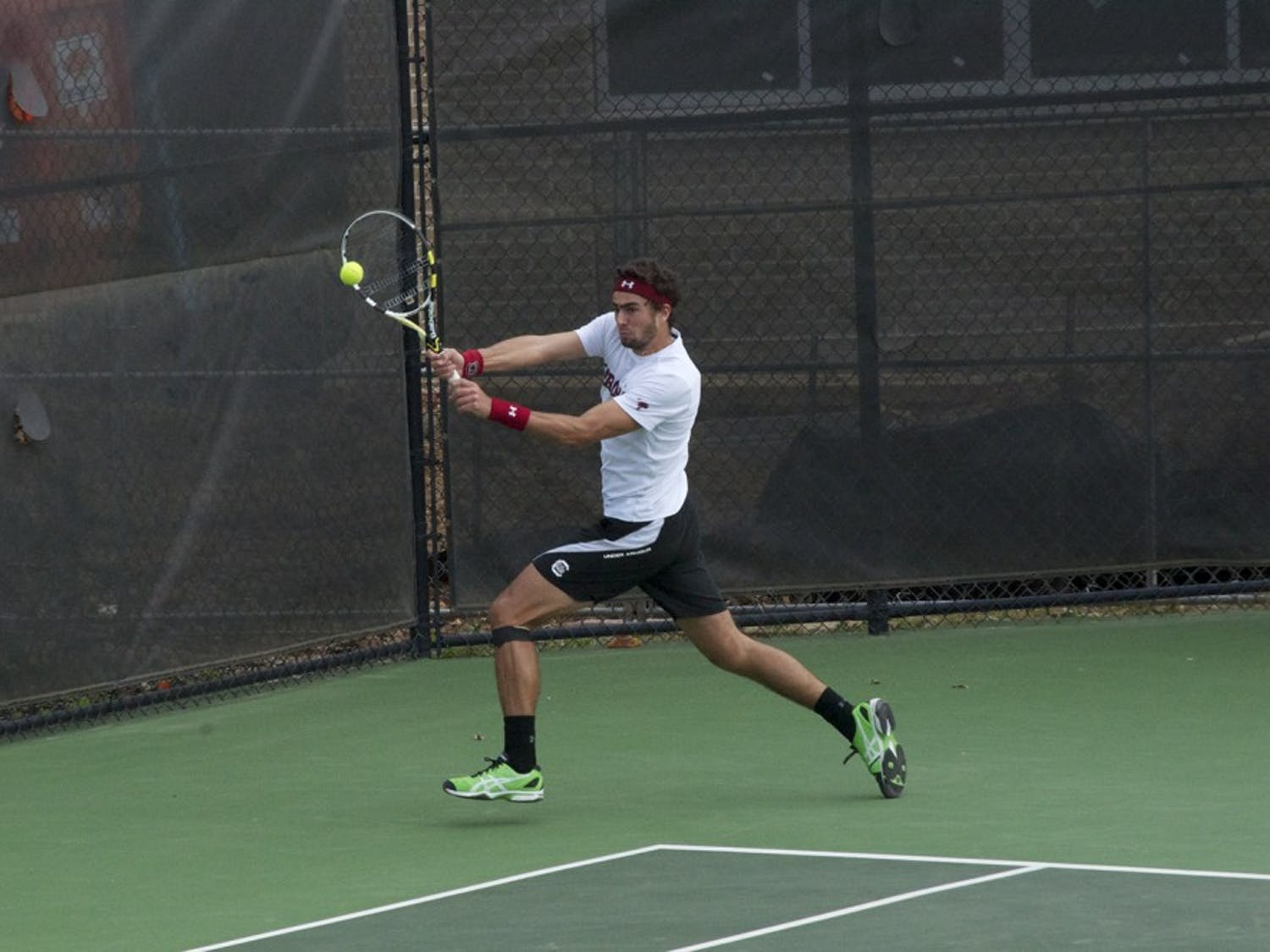 Sophomore Thiago Pinheiro (pictured) was able to cheer on sophomore teammate Kyle Koch during a break in his match.