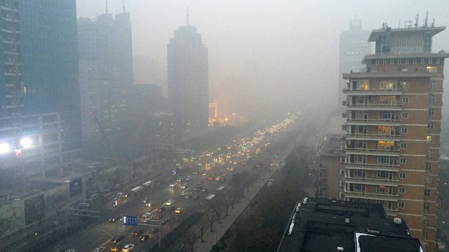Smog hangs over Beijing's main boulevard, Chang'an Avenue, looking west toward the Forbidden City, on Monday, Nov. 30, 2015. Although the city is cracking down on dirty vehicles and some power plants, the smog of the last week has demonstrated Beijing's pollution-control efforts have yet to produce lasting results. It comes as Chinese President Xi Jinping is in Paris pledging that China will reduce emissions linked to global climate change.  (Stuart Leavenworth/McClatchy/TNS)
