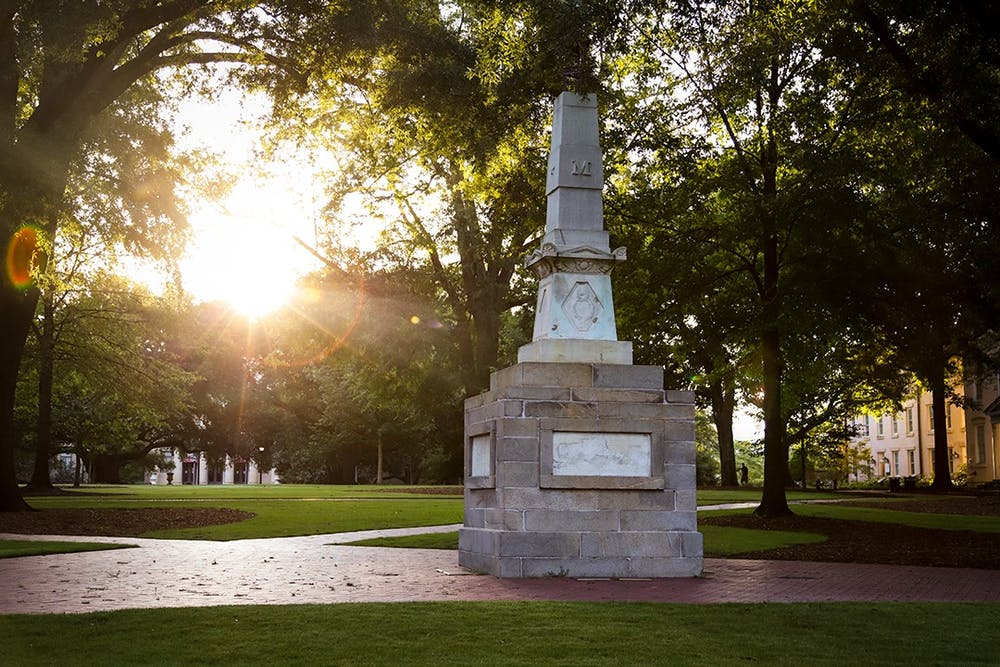 <p>The sun rises behind the Maxcy monument on the Horseshoe.&nbsp;</p>