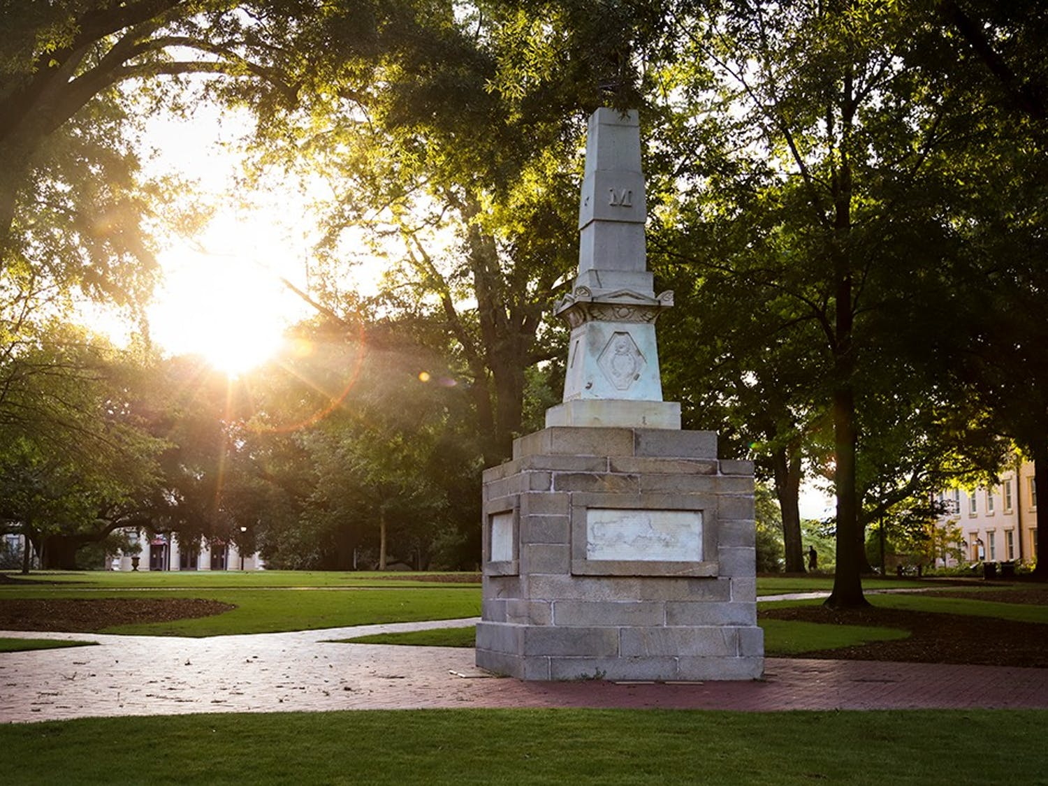 The sun rises behind the Maxcy monument on the Horseshoe.
