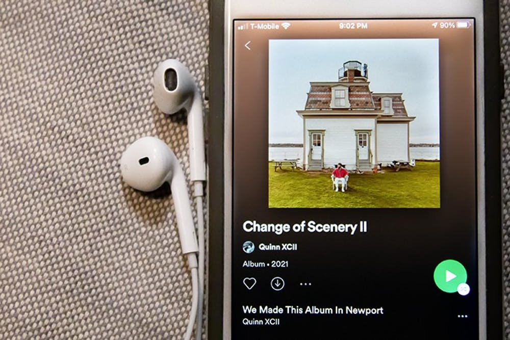 "<p>A phone playing a song from Quinn XCII's newest album, ""Change in Scenery II.""</p>"