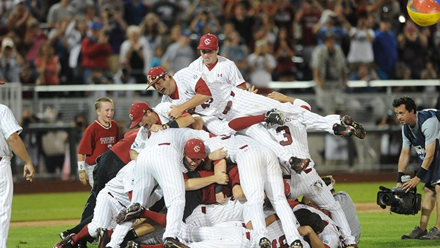 The 2011 baseball team dogpiling the field after winning the college World Series.
