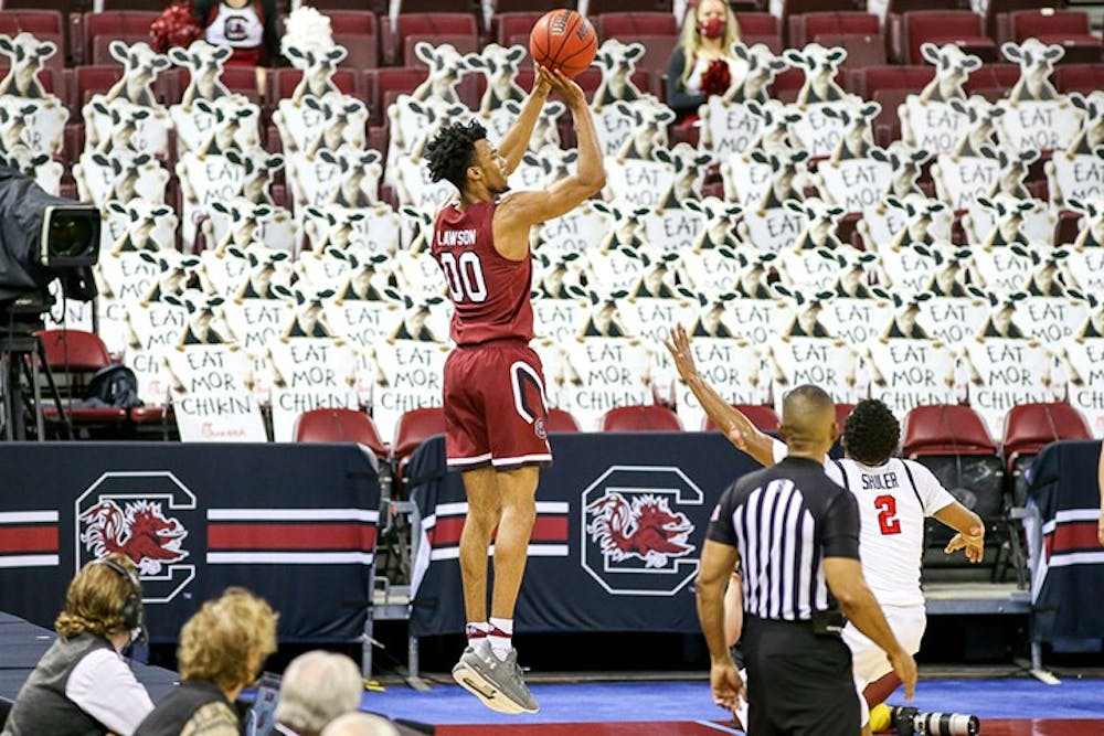 Junior guard AJ Lawson jumps to shoot the ball during the season game against Ole Miss. South Carolina lost to Ole Miss during conference play and during the SEC tournament.
