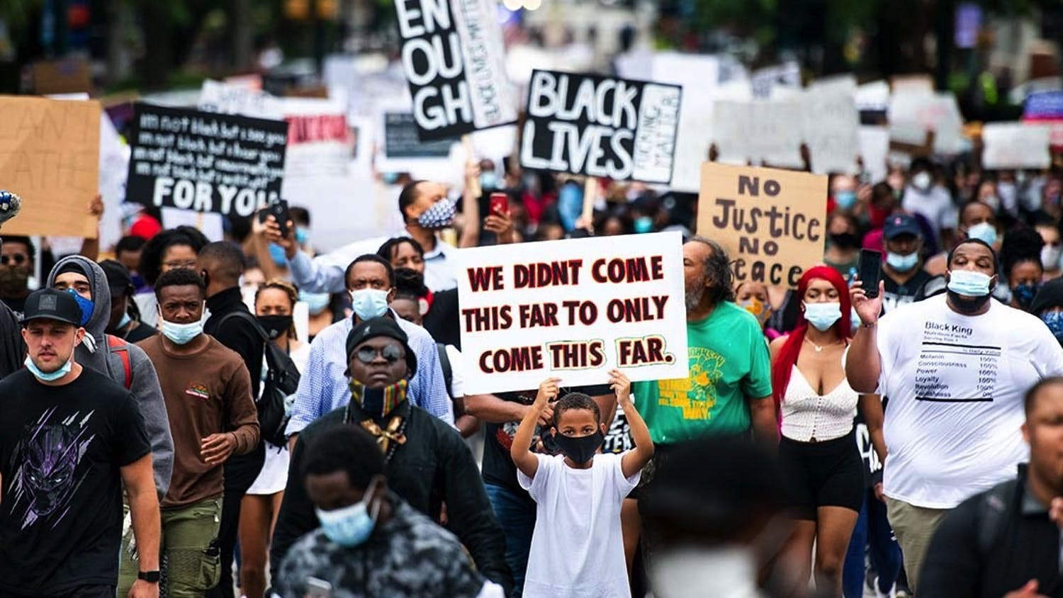 """A photograph of the Black Lives Matter march at the State Capital in 2020 in response to the murder of George Floyd. This image was taken by Sean Rayford, one of the five photojournalists featured in the """"Hindsight 2020"""" exhibit at the Columbia Museum of Art."""