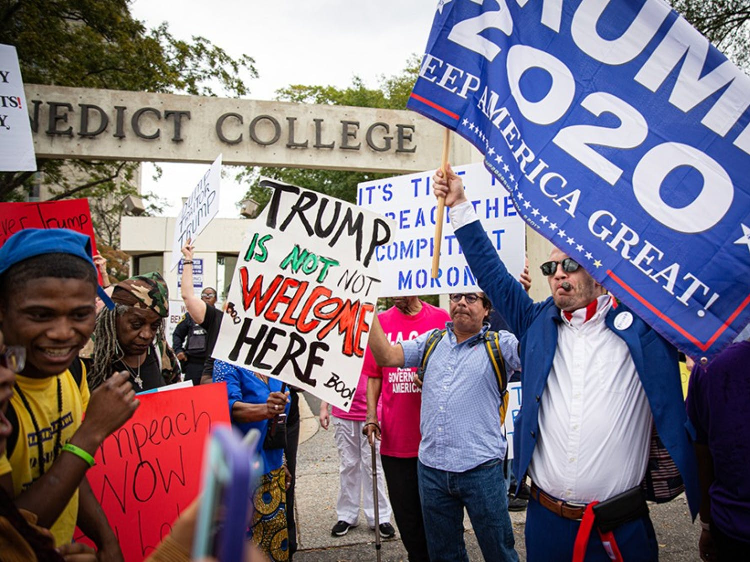 Protestors and President Trump supporters gather outside of Benedict College Oct. 25, 2019.