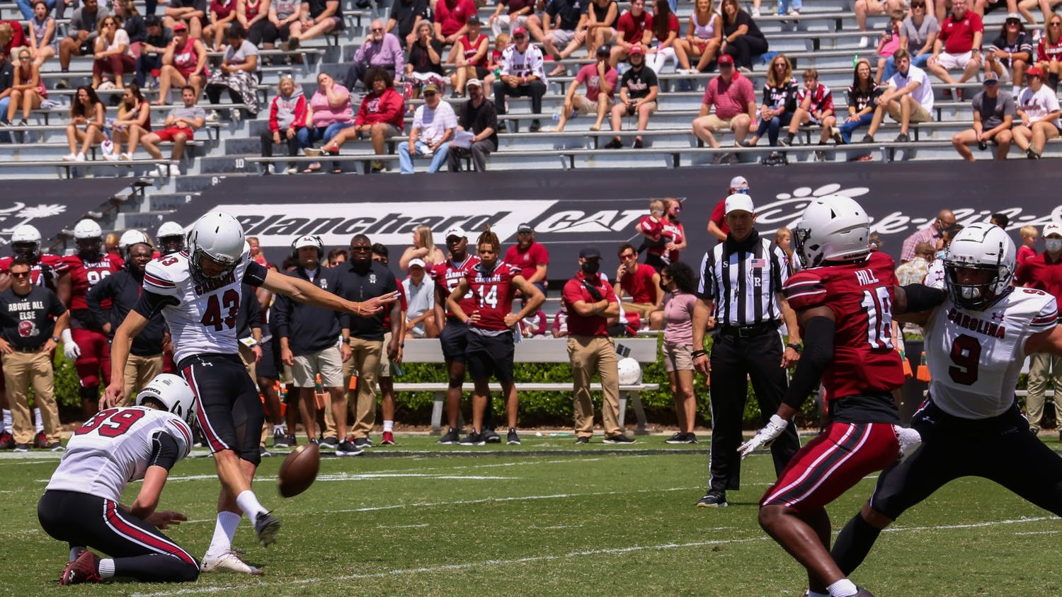 Redshirt senior kicker Parker White punts the ball down the field during the 2021 Spring Game.