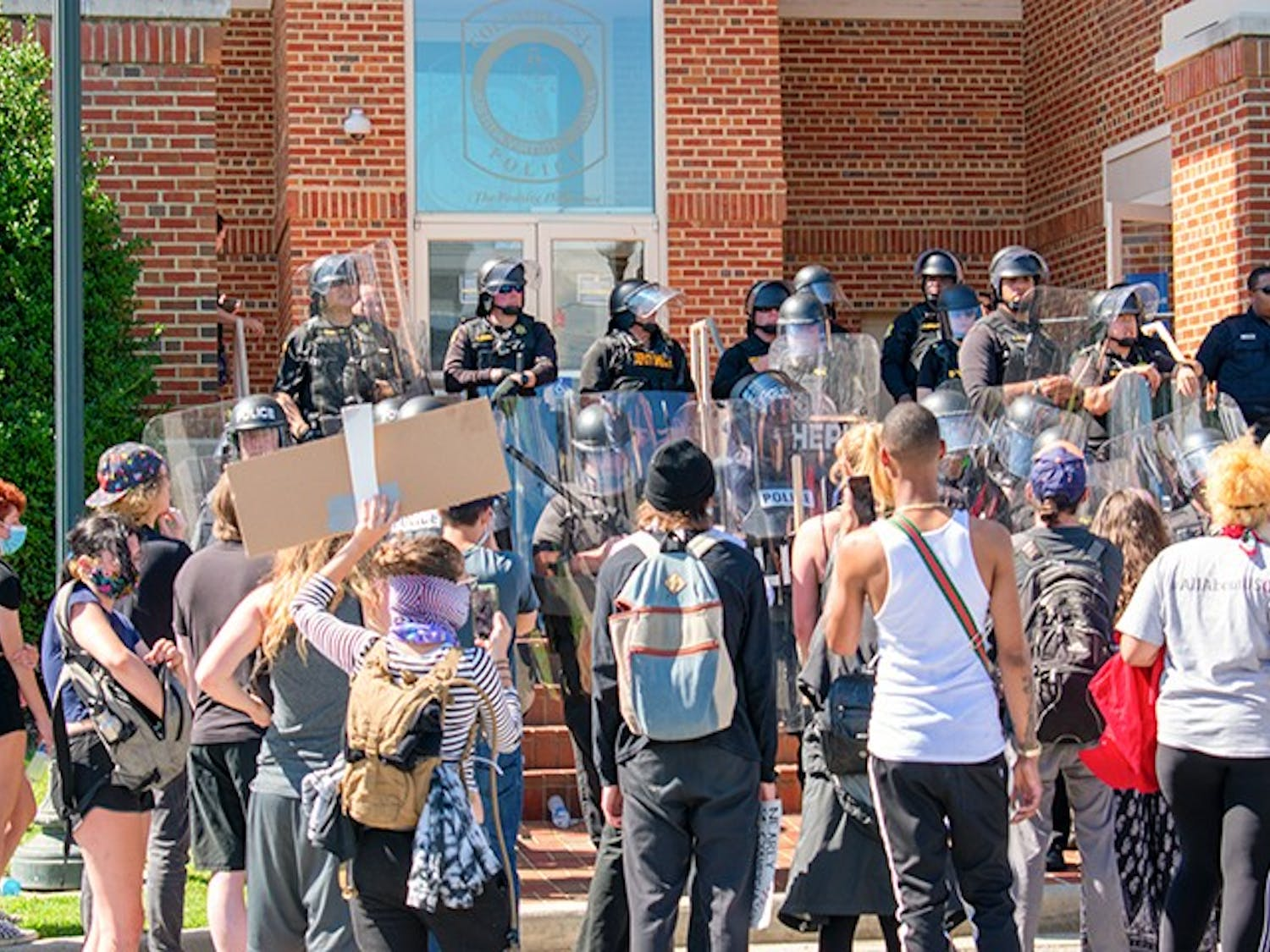 Protesters gathered in front of the Columbia Police Department. Armed police officers lined the steps of the building.