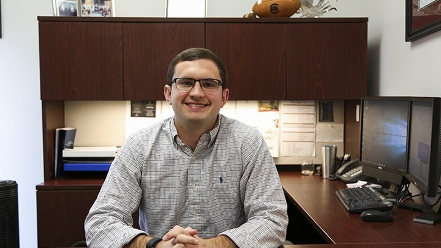 Former Student Body President Ross Lordo sits at his desk while his name plaque is displayed. In his letter, Lordo reflected on athletic achievements, the Cockstock concert and Dance Marathon.